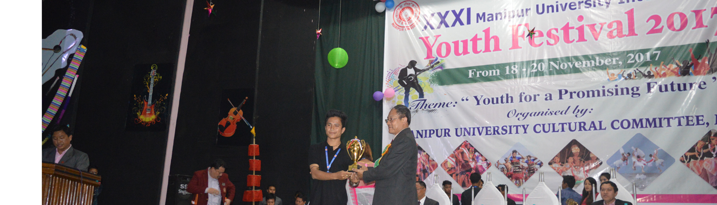 Receiving 1st Prize (Installation) from Prof N Rajmuhon Singh, Dean, School of Mathematical and Physical Sciences(MIT, Academic Matter) in XXXI Manipur University Inter College Youth Festival 2017